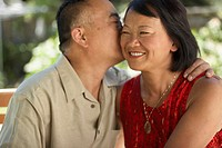 Close-up of a mature man kissing a mature woman