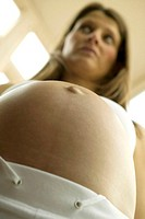 Pregnant woman's belly, close-up