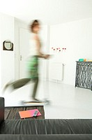 Woman using scooter in a living-room