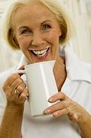 Senior woman drinking milk, close-up, portrait