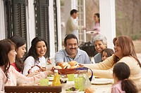 Hispanic family eating dinner outdoors, Richmond, Virginia, United States