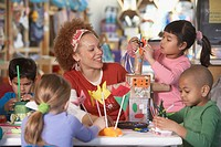 African American female Art teacher with young students (thumbnail)