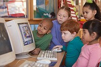 Group of young children looking at computer