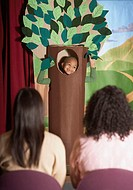 Young African American boy in tree costume on stage
