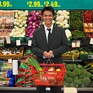 Asian man in produce section of supermarket, Perth, Australia