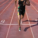 African male athlete running on track, Perth, Australia
