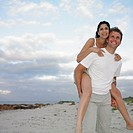 Couple playing on the beach, Busselton, Australia
