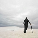 Businessman in the desert with an umbrella, Lancelin, Australia