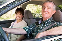 Senior Hispanic couple sitting in car