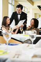 Businesswoman ordering meal in restaurant