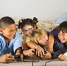 Group of children playing video games