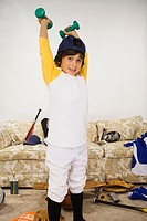 Boy in sports gear lifting weights