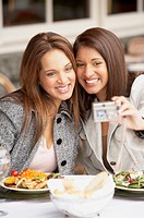 Two women taking a self-portrait at lunch, Larkspur, California, United States