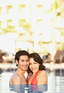 Young Hispanic couple in a pool, Los Cabos, Mexico