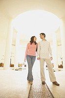 Couple walking in hotel lobby, Los Cabos, Mexico (thumbnail)