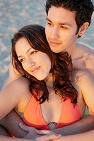 Young couple hugging on the beach, Los Cabos, Mexico
