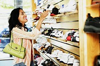 Hispanic woman at shoe store, Port Washington, New York, United States
