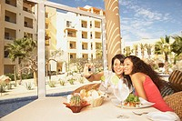 Two women taking a photograph of themselves at a resort hotel, Los Cabos, Mexico