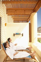 Couple relaxing on the balcony at a resort hotel, Los Cabos, Mexico