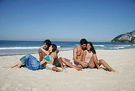 Two couples on beach