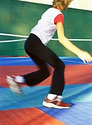 Child doing exercise, blurred motion