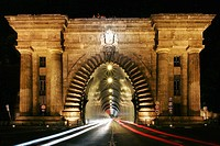 The monumental entrance to the road tunnel that runs through Castle Hill on Clark Adam Ter by night, Budapest, Hungary