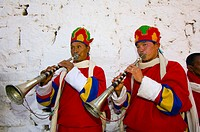 Musicians playing horns, Paro Tsechu (festival), Paro, Bhutan