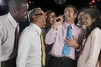 Businesspeople Singing Karaoke