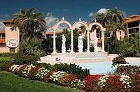 Fountains, arches, sculptures and condominiums at the San Remo Club in Redington Beach, Florida, USA.