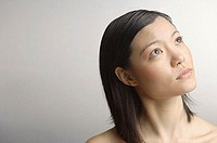 Woman looking away, head shot