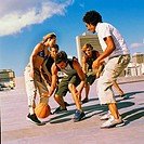 low angle view of a group of youths playing basketball