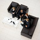 a high angle view of business executives sitting on a sofa