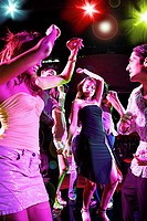 Young adults in club, dancing
