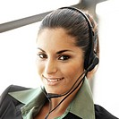 portrait of a young woman wearing a telephone headset
