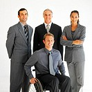 Portrait of four business executives and one of them sitting in a wheelchair