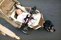 low section elevated close up view of baby (12-18 months) sleeping in buggy