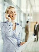 close-up of a businesswoman talking on a mobile phone in an office