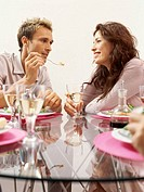 side profile of a young couple eating together