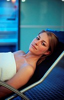 Young woman lying in a deck chair in a spa (thumbnail)