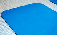 Blue mat in a fitness room of a gym, fitness center