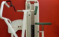 Body-building machine, athletic implement at a gym, fitness center