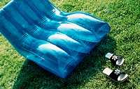 A blue inflatable deckchair on the lawn in the garden