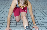 A young athletic woman, 15-20 20-25 25-30 years old, blond, sporty, stretching (thumbnail)