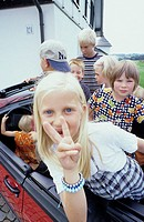 Five children, four boys, a little girl, 1-5 5-10 years old, sitting in a car, cabriolet