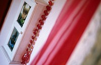 Pictures at a wall and a red curtain
