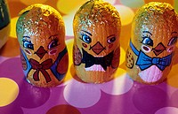 Chocolate Easter chickens, Easter biddies, on a coloured ground