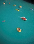 Elevated view of people boating on a lake