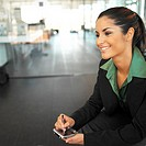 close up of a businesswoman sitting holding a personal digital assistant