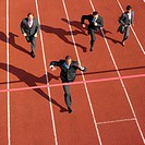 businessman winning race elevated view