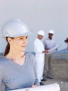 female architect holding a blueprint
